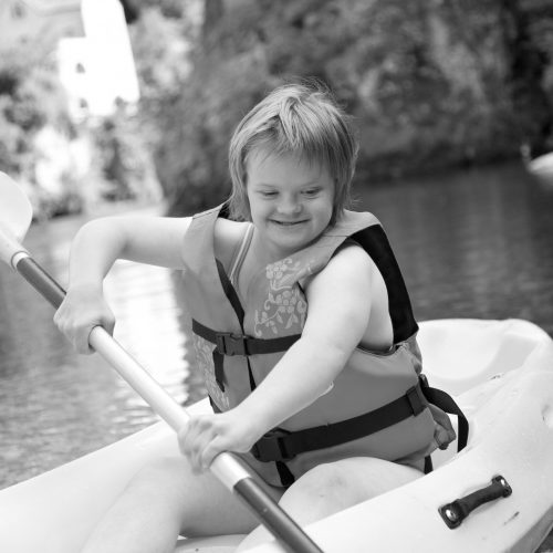 Canoeing girl with Down syndrome.